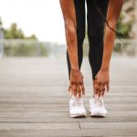 physical well-being, women warming up to run